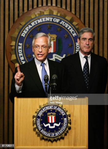 President and CEO of the National Center for Missing Exploited Children Ernie Allen speaks as FBI Director Robert Mueller listens during a news...
