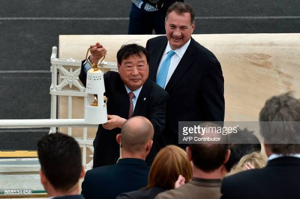 President and CEO of the Pyeongchang Organizing Committee for the 2018 Winter Olympic Games Lee Heebeom walks by President of the Greek Olympic...