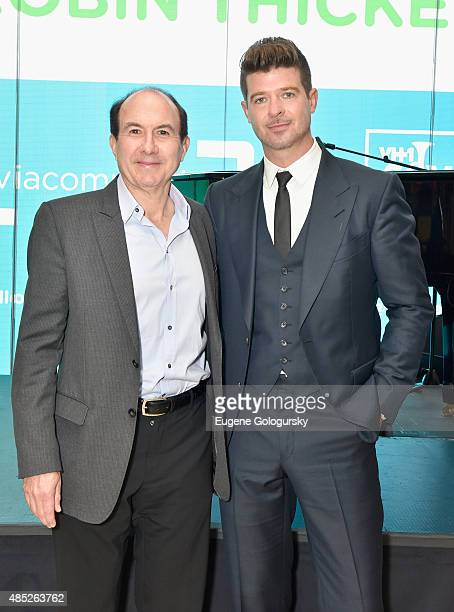 President and CEO of Viacom Philippe Dauman and Robin Thicke attend VH1 Save The Music Foundation Viacommunity Robin Thicke Piano Delivery on August...