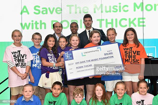 President and CEO of Viacom Philippe Dauman Executive Director VH1 Save the Music Paul Cothran and Robin Thicke attend VH1 Save The Music Foundation...