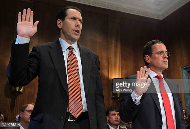 President and CEO Randall Stephenson and TMobile USA President and CEO Philipp Humm are sworn in during a hearing before the Antitrust Competition...