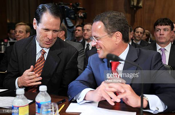 President and CEO Randall Stephenson talks to T-Mobile USA President and CEO Philipp Humm as they wait for the beginning of a hearing before the...