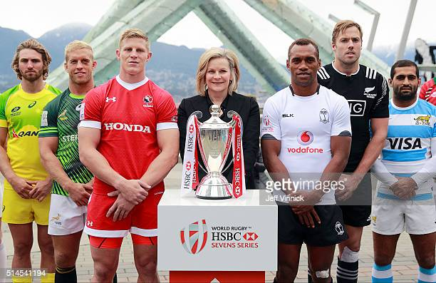President and CEO Sandra Stuart stands between six of the captains of the Rugby Sevens tournament teams as they pose for a group photograph in front...