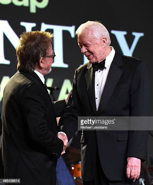 President and Chairman of the Board Paul Williams and President Jimmy Carter speak onstage during the 53rd annual ASCAP Country Music awards at the...