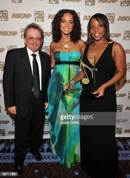 President and Chairman Paul Williams musician Alicia Keys and Assistant Vice President Membership Rhythm Soul ASCAP Nicole George pose in the press...