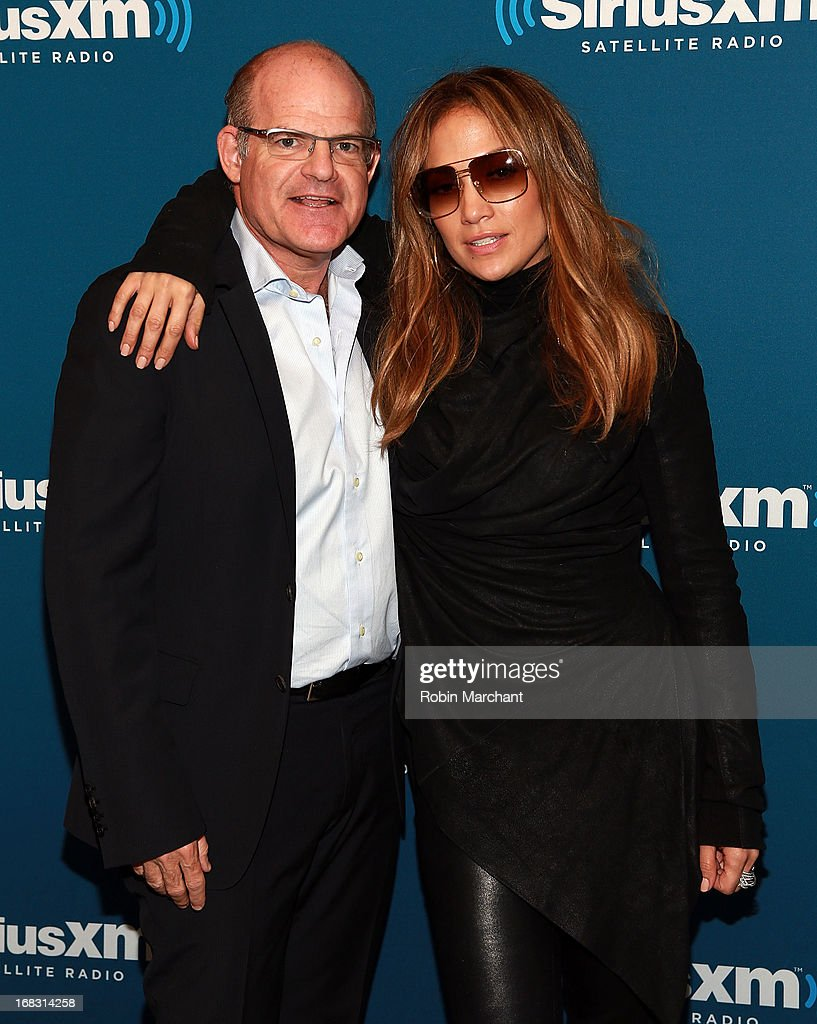 President and Chief Content Officer of Sirius XM Radio, Scott Greenstein (L) and Jennifer Lopez visit at SiriusXM Studios on May 8, 2013 in New York City.