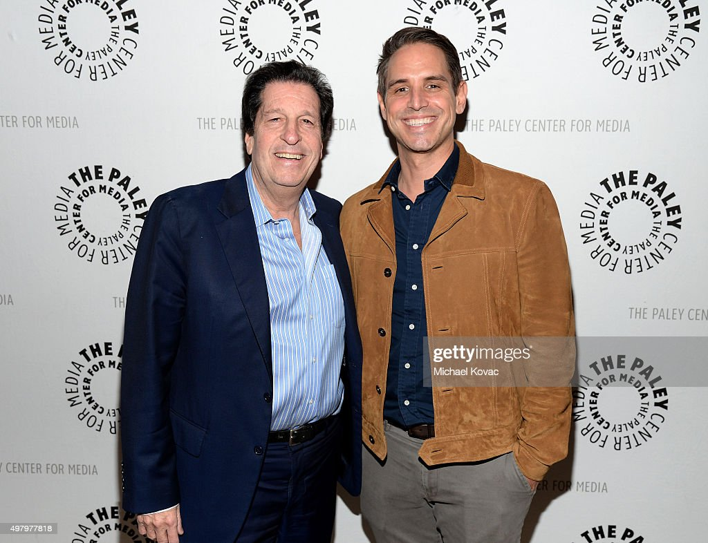 President and Chief Content Officer of Warner Bros Television Group Peter Roth (L) and producer Greg Berlanti attend Paley Media Council Presents Paley Dialogue With Peter Roth And Greg Berlanti at The Paley Center for Media on November 19, 2015 in Beverly Hills, California.