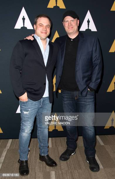 President and chief creative officer at DC Entertainment Geoff Johns and Producer/president of Marvel Studios Kevin Feige attend An Academy Tribute...