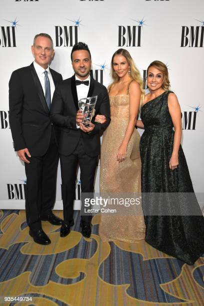 BMI President and Chief Executive Officer Michael O'Neill honoree Luis Fonsi Agueda Lopez and BMI Vice President of Latin Music Delia Orjuela attend...