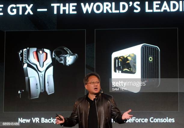 President and Chief Executive Officer of NVIDIA, Huang Jen-hsun speaks during the Computex Show in Taipei on May 30, 2017. More then 5,000 booths...