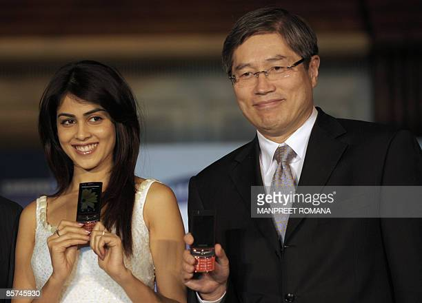 President and Chief Executive Officer of Samsung India Electronics Jung Soo Shin and Indian actress Genelia D'Souza pose for pictures during the...