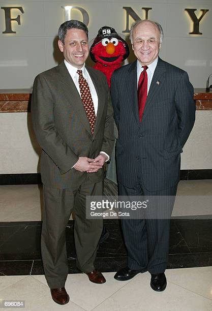 President and Chief Executive Officer of the Childrens Television Workshop Gary Knell Elmo and FDNY Commissioner Nicholas Scoppetta attend the 33rd...