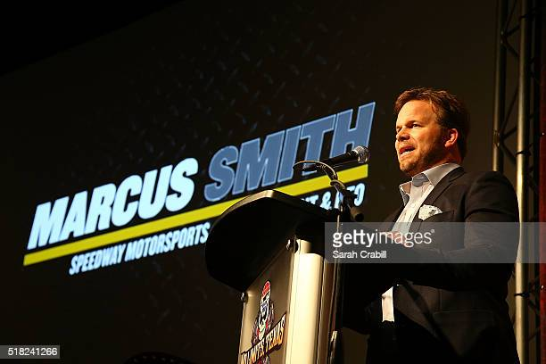 President and Chief Operating Officer of Speedway Motorsports Inc Marcus Smith announces the SMI Track of the Year award winner during the Texas...