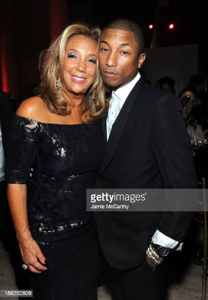 President and Cofounder of Gabrielle's Angel Foundation Denise Rich and Pharrell Williams attend Gabrielle's Angel Foundation Hosts Angel Ball 2013...