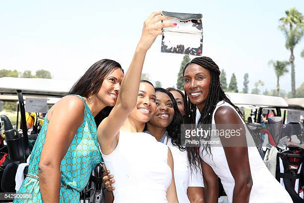 President and COO of LA Sparks Christine Simmons and former professional woman's basketball player Lisa Leslie pose for a selfie with guests during...