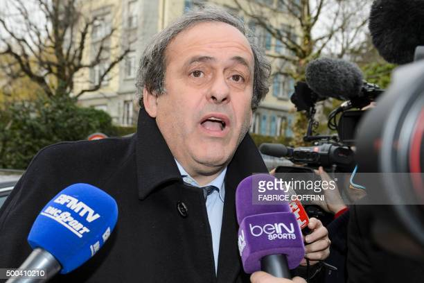 UEFA president and FIFA vice president Michel Platini speaks to the press as he arrives at the Court of Arbitration for Sport to appeal against a...