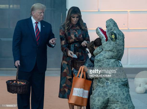 President and First Lady Melania Trump arrive to hand out candy for children at a Halloween celebration at the White House in Washington DC on...