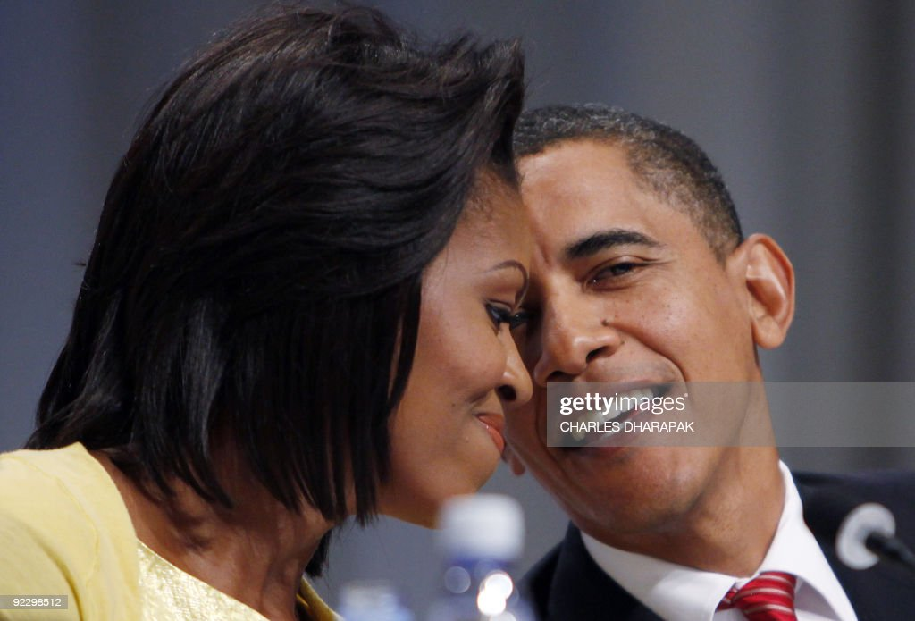 US President and former Illinois senator Barack Obama embraces his wife US first lady Michelle Obama after he presented Chicago's bid for the 2016 Olympics, on October 2, 2009 in Copenhagen. The International Olympic Committee (IOC) will vote on the destiny of the 2016 Summer Olympic Games after a final round battle.