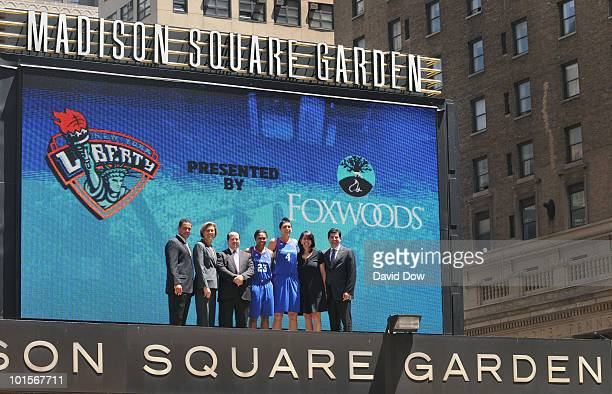 President and General Manager Carol Blazejowski Cappie Pondexter and Janel Mccarville of the New York Liberty pose for a photograph with President of...