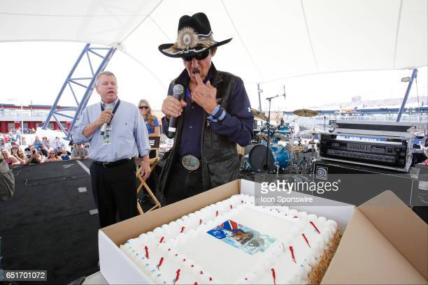 LVMS President and General Manager Chris Powell presents Richard Petty a birthday cake on the Neon Garage Stage during Stratosphere Pole Day for the...