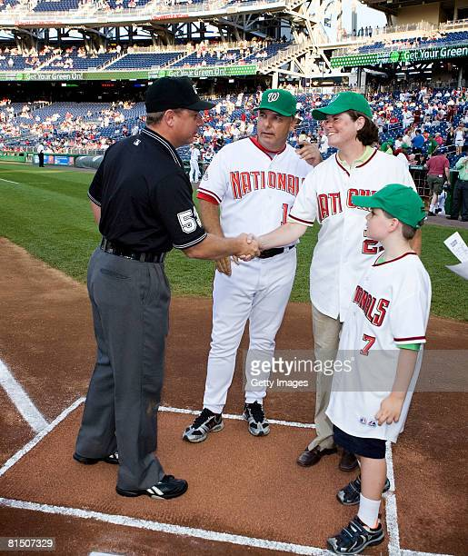 President and General Manager of Planet Green Eileen O'Neill and son Quinn StoddardO'Neill shake hands with first base umpire Greg Gibson as...