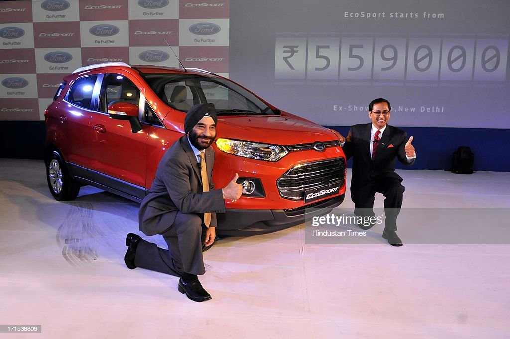 President and Managing Director of Ford India, Joginder Singh and Vinay Piparsania, Executive Director for Marketing Sales and service, pose with newly launched Ford EcoSport on June 26, 2013 in New Delhi, India. The model will be available with three engine options of 1 litre petrol with Ecoboost technology, 1.5 litre petrol and 1.5 litre diesel engine.