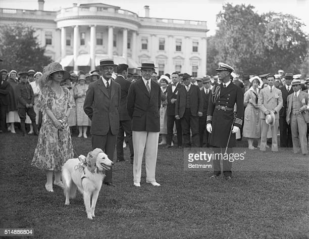 President and Mrs. Calvin Coolidge with Andrew Mellon and others on the White House lawn.