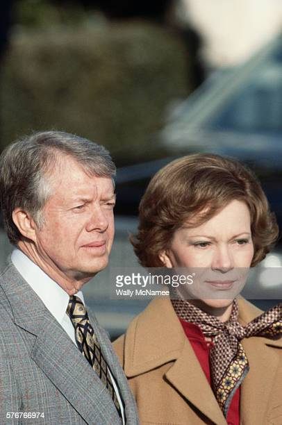 President and Mrs Carter watch solemnly as Egyptian President Anwar elSadat and his wife leave the White House at the end of a state visit