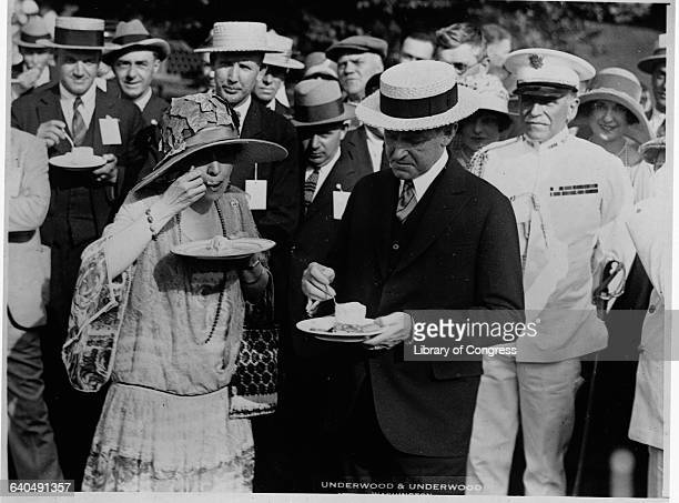 President and Mrs. Coolidge eat ice cream at a garden party for veterans at the White House.