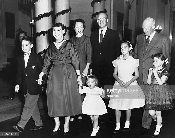 President and Mrs Eisenhower at the White House on Christmas Day with their son and his family from left to right are David Mamie Barbara Mary John...