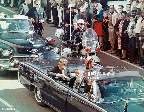 President and Mrs. John F. Kennedy smile at the crowds lining their motorcade route in Dallas, Texas, on November 22, 1963. Minutes later the...