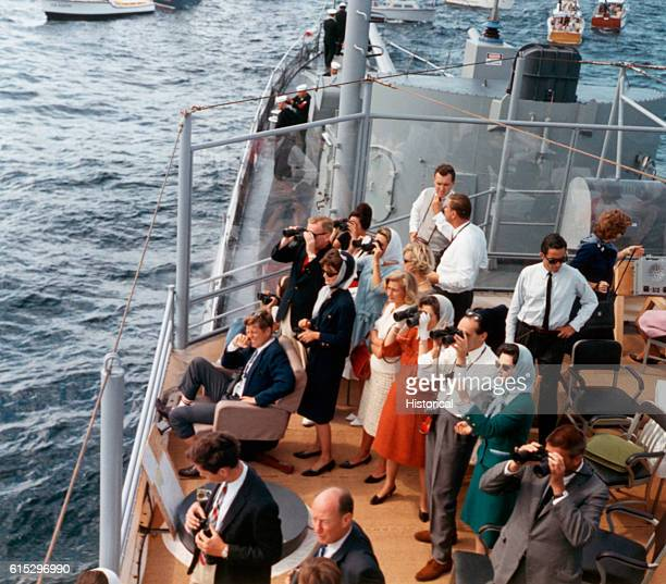 President and Mrs Kennedy along with various politicians watch the America's Cup race from the deck of a boat September 15 1962