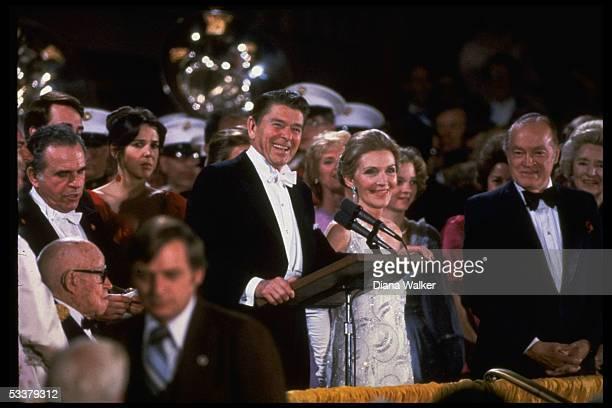 President and Nancy Reagan at podium at inaugural gala, Kennedy Center; Bob Hope & wife Patti Reagan Omar Bradley, lower right.