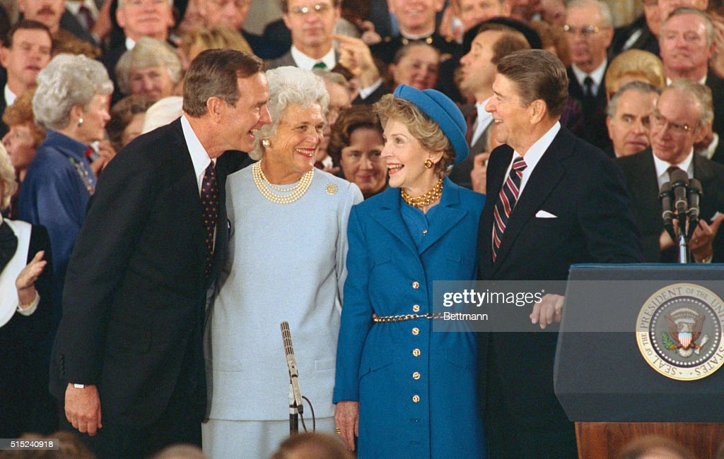 President and Nancy Reagan laugh with Vice President and Barbara Bush during inaugural ceremonies at the Capitol.