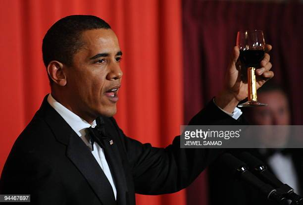 US President and Nobel Peace Prize laureate Barack Obama raises his glass as he makes a toast during the Nobel Banquet in Oslo on December 10 2009...