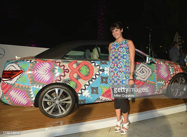 President and Partner at People's Revolution Emily Bungert poses in front of the 2014 MercedesBenz E350 Cabriolet by Mara Hoffman at MercedesBenz...