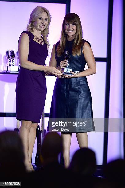 President and Publisher Nashville Business Journal Kate Herman presents Creative Artists Agency's Human Resource Executive Brandi Brammer with a 2015...