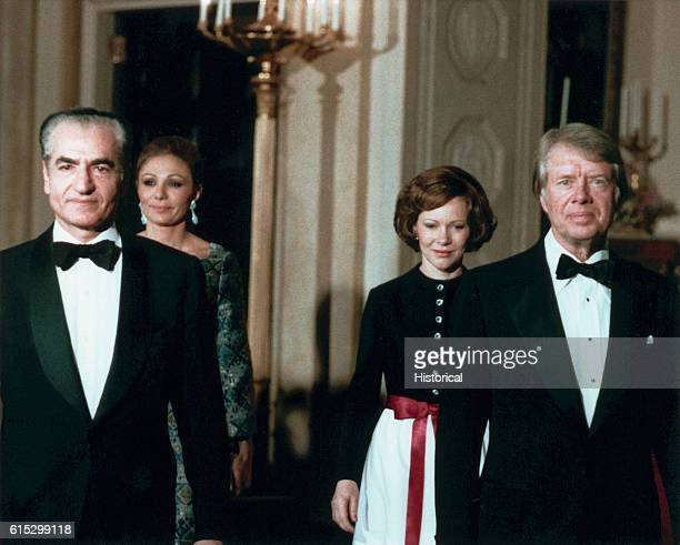 President and Rosalynn escort the Shah and Shahbanou of Iran to a state dinner in the White House