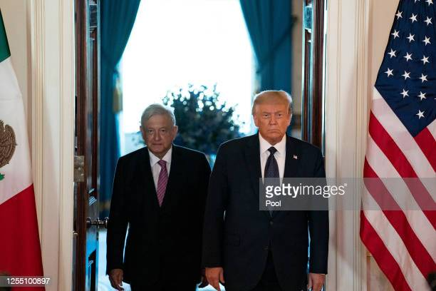 President Andrés Manuel López Obrador of Mexico and US President Donald Trump arrive before speaking before a working dinner at the White House July...