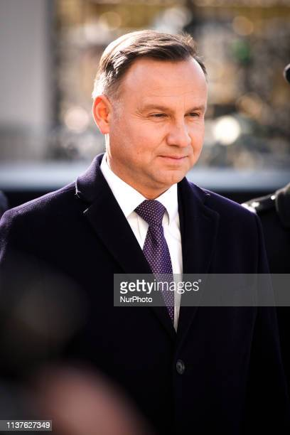 President Andrzej Duda places a remembrance lantern at a commemoration plaque for former Polish President Lech Kaczynski at the Presidential Palace...