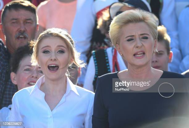 President Andrzej Duda's wife Agata and daughter Kinga seen during Polish National Anthem on the final day of Duda's presidential campaign rally in...