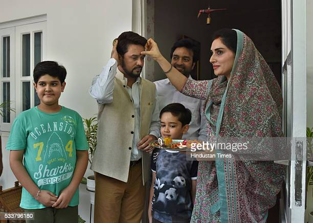 President Anurag Thakur being greeted by family members at his residence on May 23 2016 in New Delhi India