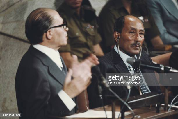 President Anwar Sadat of Egypt on right looks on as Prime Minister Menachem Begin of Isreal addresses the Knesset in Jerusalem Israel on 20th...