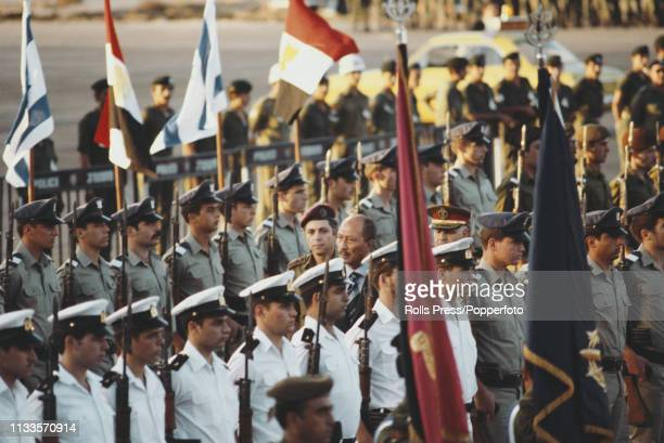 President Anwar Sadat of Egypt pictured inspecting an Israel Defense Forces guard of honour at Ben Gurion airport in Tel Aviv as he prepares to leave...