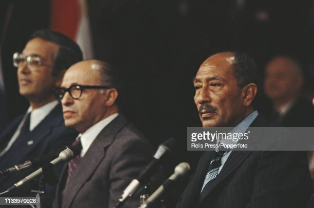 President Anwar Sadat of Egypt pictured on right with Prime Minister Menachem Begin of Israel as they address a joint press conference in Jerusalem...