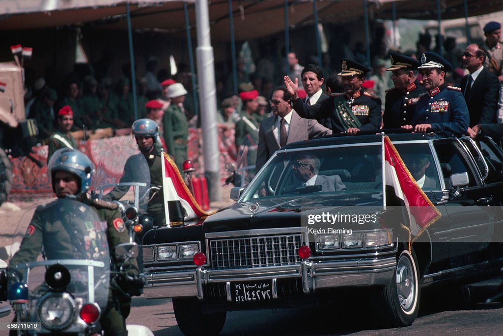 Anwar Sadat Riding in an Open Limousine : News Photo