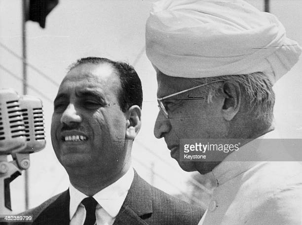 President Aref of Iraq giving a speech standing next to President Dr Radhakrishnan New Delhi India March 31st 1964