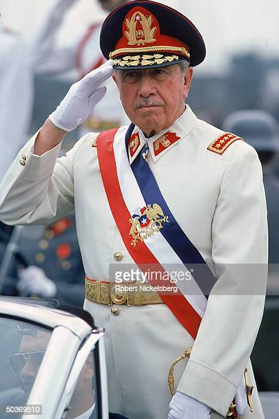 President Augusto Pinochet, saluting, on Armed Forces Day.