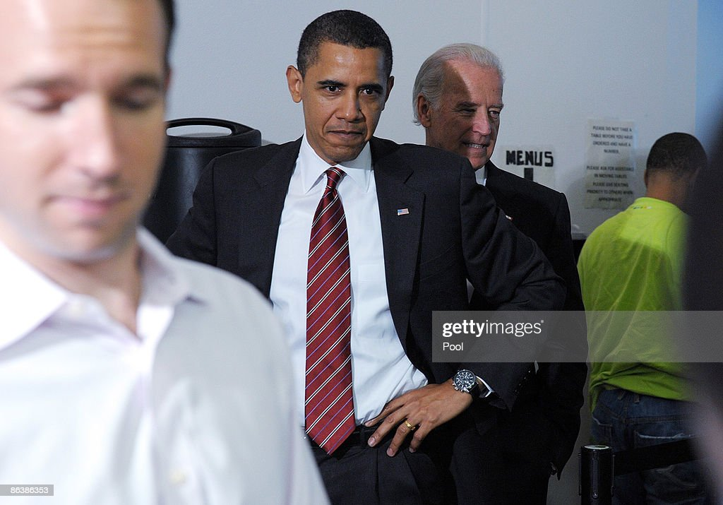 U.S. President Barack Obama a(2nd L) nd Vice President Joe Biden (2nd R) stand in line before ordering lunch at Ray's Hell Burger May 5, 2009 in Arlington, Virginia. Obama and Biden made an unannouced vist to the Arlington restaurant.