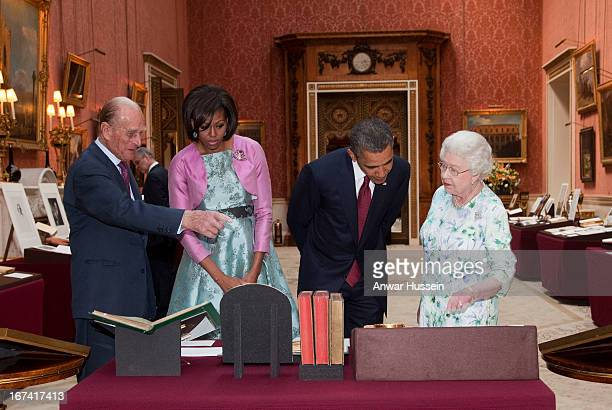 President Barack Obama accompanied by his wife Michelle Obama is shown items from the Royal Collection by Queen Elizabeth II and Prince Philip Duke...
